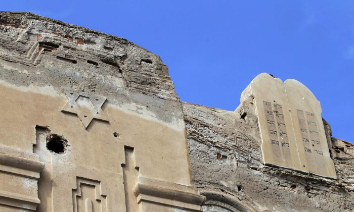 A picture shows the Ten Commandments written in Hebrew on stone tablets on top of the abandoned Dar Bishi synagogue in the Libyan capital Tripoli on Sept. 28, 2011. The Jewish community in Libya dates back to the third century BC and at its peak numbered around 38,000 people, although it was always the smallest of the Jewish populations in north Africa. Most of the Jewish population left in the 20 years following World War II, although several hundred were still living there during ousted leader Moamer Kadhafi's coup of 1969. (Joseph Eid/AFP/Getty Images)