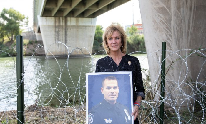 Mary Ann Mendoza, whose son Sgt Brandon Mendoza was killed by an illegal alien, stands next to the Rio Grande, which is the border between the U.S. and Mexico, in Hidalgo, Texas, on Nov. 5, 2018. (Samira Bouaou/The Epoch Times)