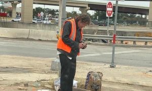 Texas Couple Raises $1,500 for Homeless Man Who Sells Newspapers