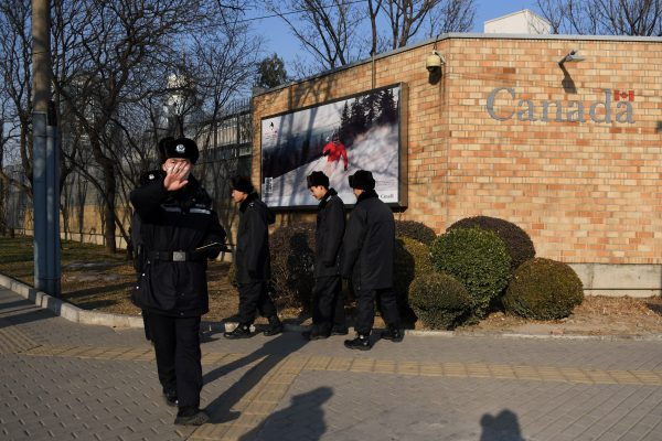 chinese police blocking photo at the canadian embassy in beijing
