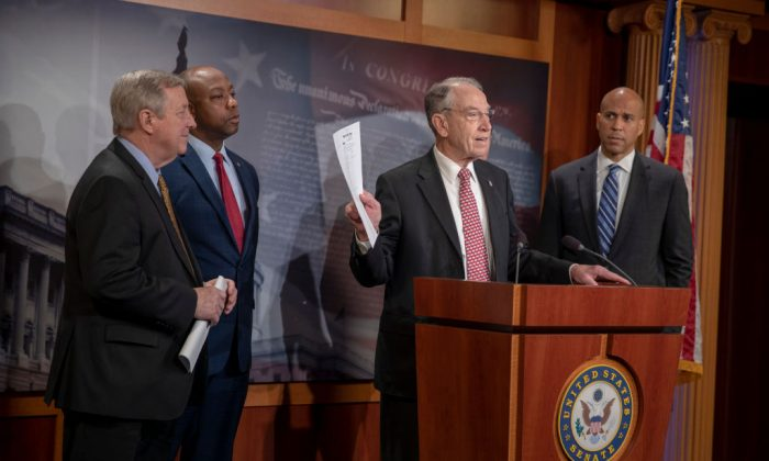 Sen. Dick Durbin (D-IL) and Sen. Corry Booker (D-N.J.) listen to Senate Judiciary Committee Chairman Chuck Grassley (R-IA) speak on the passage of the First Step Act on Dec. 19, 2018, in Washington. (Tasos Katopodis/Getty Images)