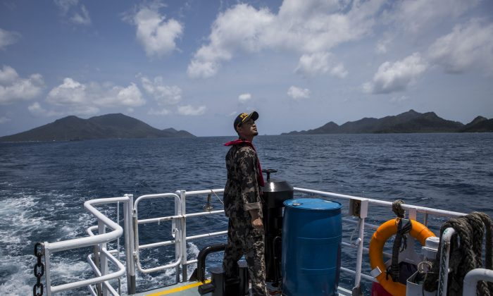 A security ship crew of Ministry of Maritime Affairs and Fisheries prepares to anchor in Natuna during a security patrols along Indonesia's Exclusive Economic Zone (EEZ) in Natuna, Ranai, Indonesia on Aug. 16, 2016. (Ulet Ifansasti/Getty Images)
