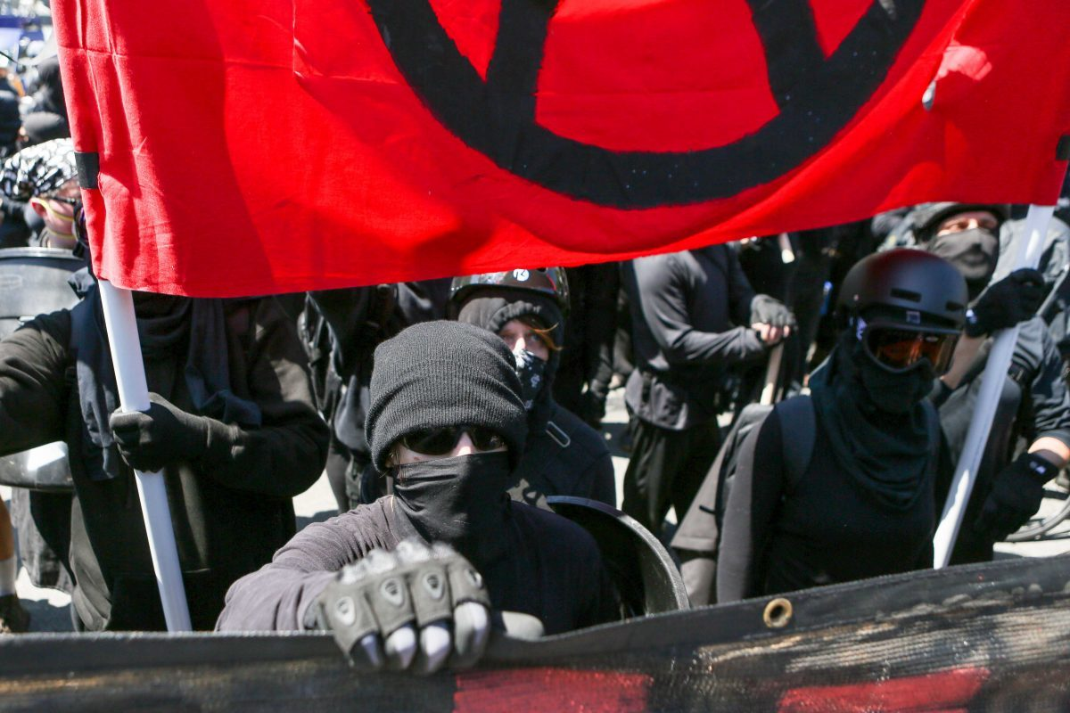 Antifa members and counter protesters gather during a rally