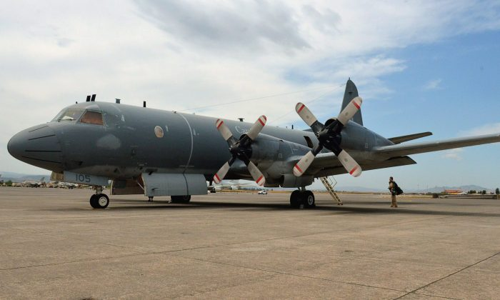 A Canadian CP-140 Aurora on the tarmac at the Italian naval air station in Sigonella, Italy in this file photo. This same type of plane was treated in an inappropriate manner by Chinese military in October near North Korea. (The Canadian Press/Murray Brewster)