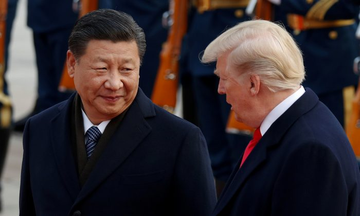U.S. President Donald Trump takes part in a welcoming ceremony with Chinese leader Xi Jinping at the Great Hall of the People in Beijing on Nov. 9, 2017. (Damir Sagolj/Reuters)