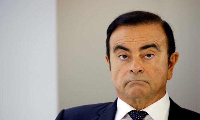 Carlos Ghosn, chairman and CEO of the Renault-Nissan-Mitsubishi Alliance, attends a press conference on the second press day of the Paris auto show, in Paris, France, on Oct. 3, 2018. (Regis Duvignau/Reuters)