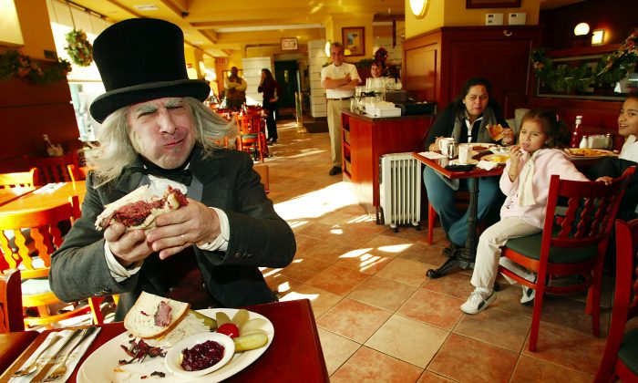 "Ebenezer Scrooge from Radio City Entertainment's ""A Christmas Carol"" creates and enjoys the ""Scrooge Sandwich"" at the Stage Door Deli in New York City. (Scott Gries/ImageDirect)"