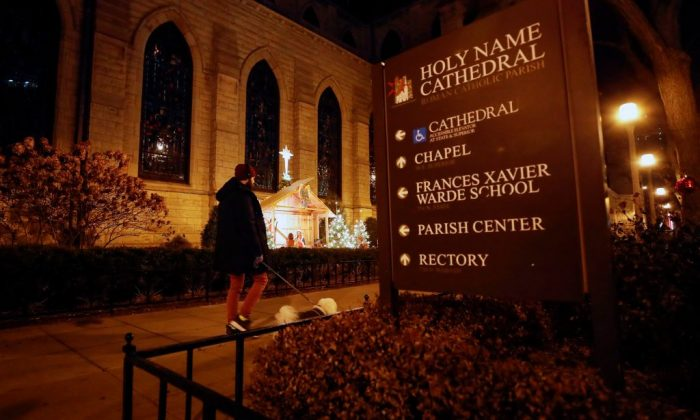 A man walks a dog past the Holy Name Cathedral in Chicago on Dec. 19, 2018. Almost 700 clergy in Illinois have been accused of child sexual assault, a far greater number than the Catholic Church had previously disclosed, the U.S. state's top prosecutor revealed on Dec. 19. (KAMIL KRZACZYNSKI/AFP/Getty Images)