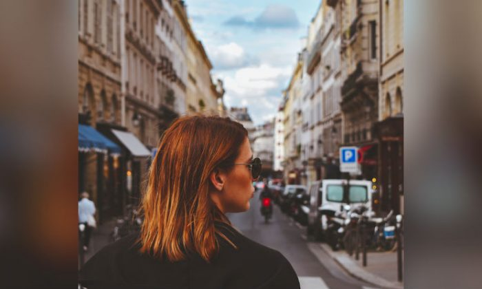 Stock photo of a girl in Paris. (Buco Balkanessi/Unsplash)