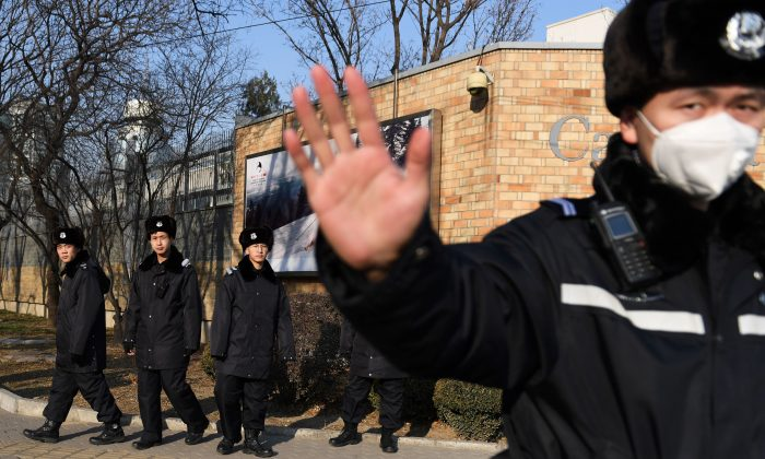 Chinese police patrol in front of the Canadian embassy in Beijing on Dec. 14, 2018. (Greg Baker/AFP/Getty Images)