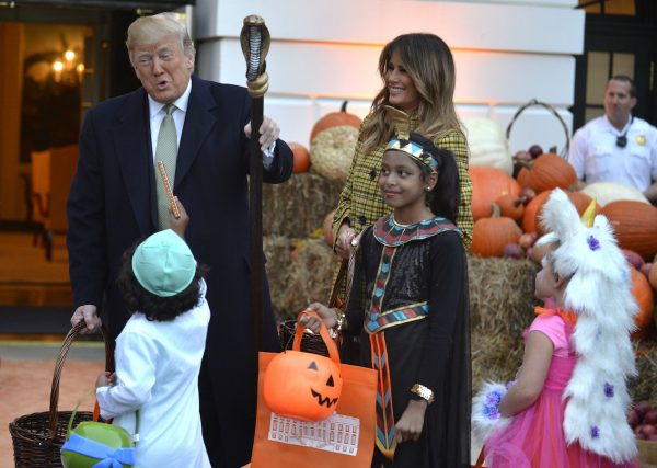 Trump and Melania welcome trick-or-treaters to the White House.