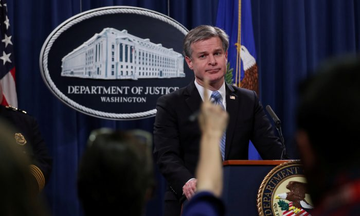 FBI Director Christopher Wray answers questions from reporters during a news conference at the Justice Department in Washington, D.C. on Oct. 26, 2018. (Jonathan Ernst/Reuters)
