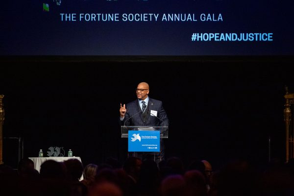 Richards speaks at a gala
