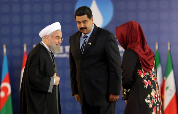 Iranian President Hassan Rouhani (L), greets his Venezuelan counterpart Nicolas Maduro and Venezuela's First Lady Cilia Flores during the Gas Exporting Countries Forum (GECF) summit in Tehran on Nov. 23, 2015. (Atta Kenare/AFP/Getty Images)