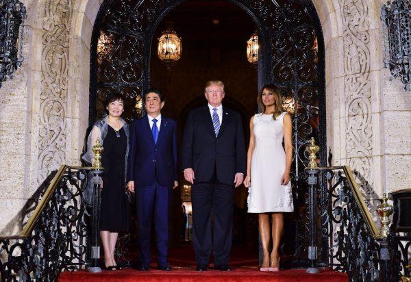 Trump Melania greet Japan's Prime Minister Shinzo Abe and his wife Akie Abe.