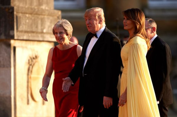 Trump and Melania welcome by British prime minister Theresa May.