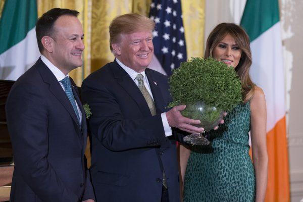 Trump Melania and Prime Minister Leo Varadkar of Ireland during the Shamrock Bowl Presentation.