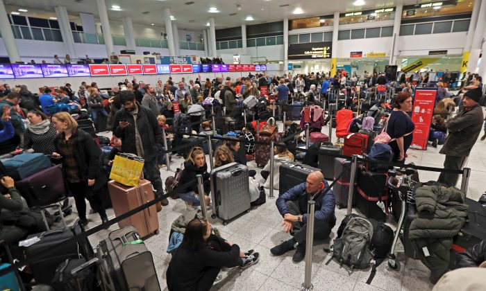 Passengers wait around in the South Terminal building at Gatwick Airport after drones flying illegally over the airfield forced the closure of the airport on Dec. 20, 2018. (Reuters/Peter Nicholls)