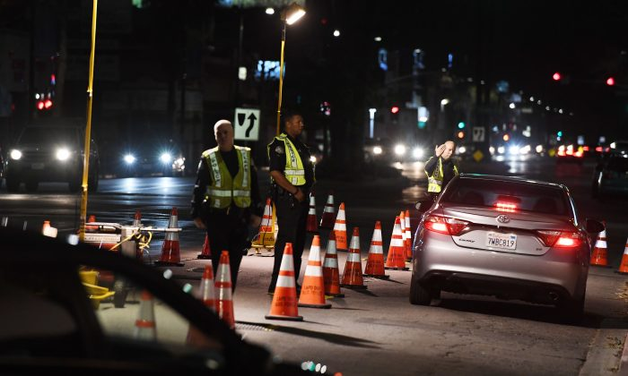 LAPD officers check drivers at a DUI checkpoint in Reseda, Los Angeles, Calif., on April 13, 2018.  (Mark Ralston/AFP/Getty Images)