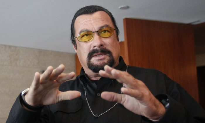 U.S. actor Steven Seagal speaks to the media at a news conference in Moscow June 2, 2013.     (Reuters/Maxim Shemetov)