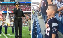 Cute little boy shows great American pride as he belts his heart out during National Anthem