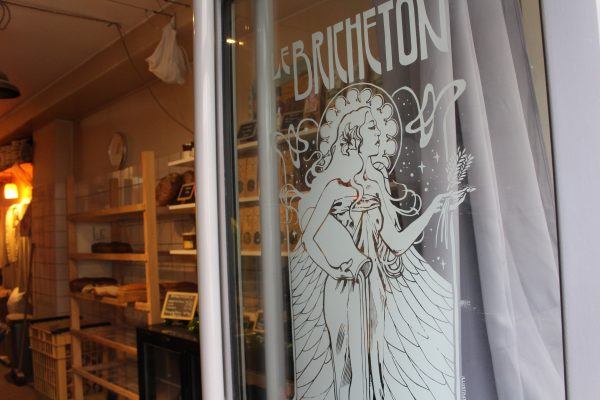 The storefront of the bakery has an illustration