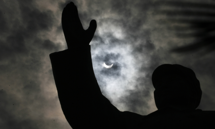 A silhouette of Mao Zedong under a clouded moon in Wuhan, Hubei province, on July 22, 2009.(AFP/AFP/Getty Images)