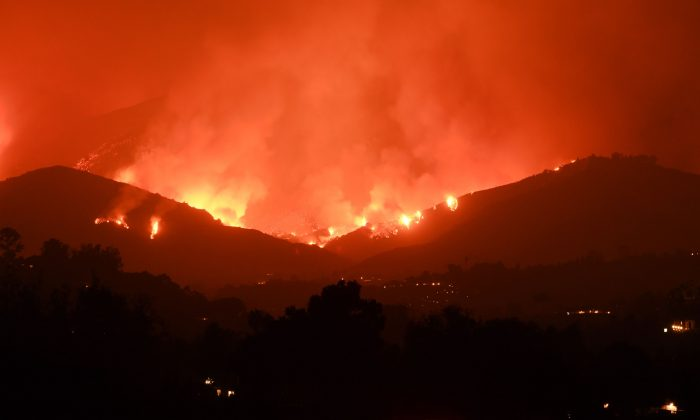 Flames from the Thomas Fire in the hills of Montecito, California, Dec. 11, 2017. (ROBYN BECK/AFP/Getty Images)