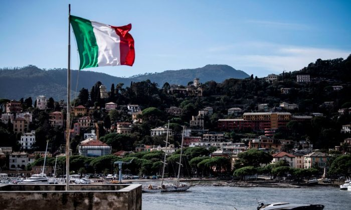 The Italian flag flies over the harbour of Rapallo, near Genoa, on Oct. 30, 2018. (Marco Bertorello/AFP/Getty Images)