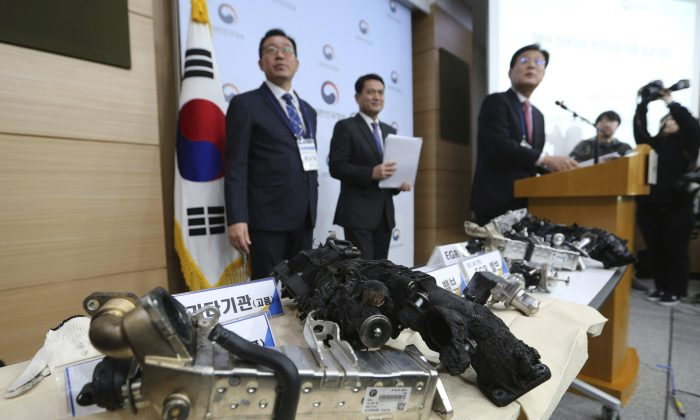 South Korean Transport Ministry officials hold a press conference as damaged gears of a BMW which engine had caught fire are displayed at the government complex in Seoul, South Korea, on Dec. 24, 2018. (Ahn Young-joon/AP)
