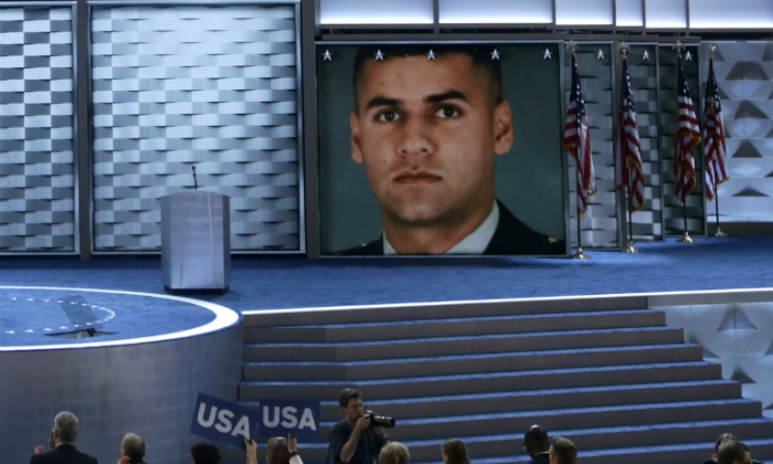 An image of deceased U.S. Army Capt. Humayun S. M. Khan is displayed on a screen as his father Khizr Khan delivers remarks on the fourth day of the Democratic National Convention at the Wells Fargo Center, in Philadelphia, Penn., on July 28, 2016. (Joe Raedle/Getty Images)