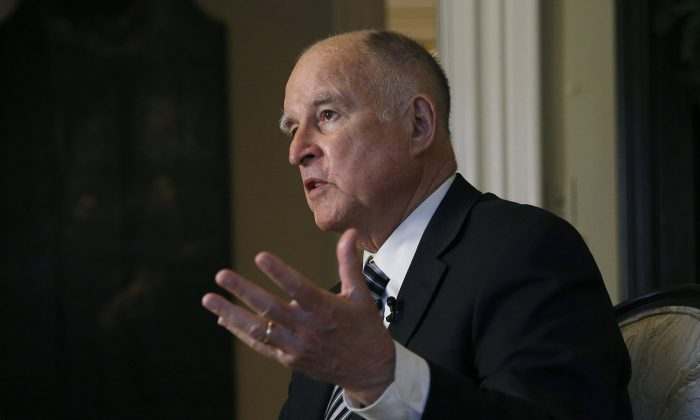 California Gov. Jerry Brown talks during an interview in Sacramento, Calif. on Dec. 18, 2018. (AP Photo/Rich Pedroncelli, File)