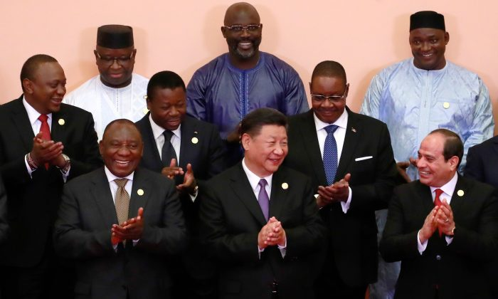 Chinese leader Xi Jinping and Malawi's President Arthur Peter Mutharika (2nd row R) along with other African leaders attend a group photo session during the Forum on China-Africa Cooperation in Beijing on Sept. 3, 2018. (How Hwee Young/AFP/Getty Images)