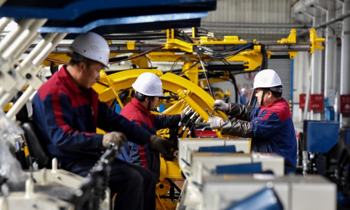 Employees work on a drilling machine production line at a factory in Zhangjiakou in China's northern Hebei Province on Nov. 14, 2018. (STR/AFP/Getty Images)
