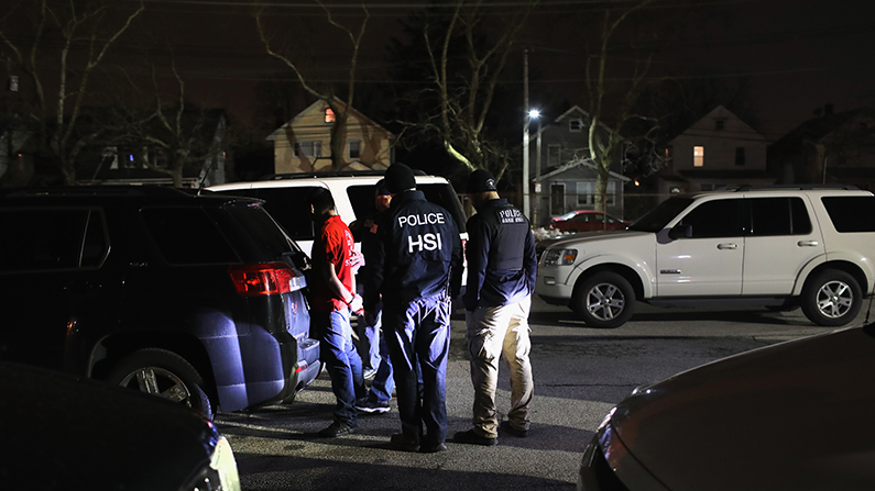ICE agents detain a suspected MS-13 gang member