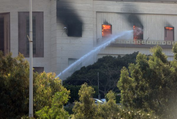 firemen hose down burning foreign ministry