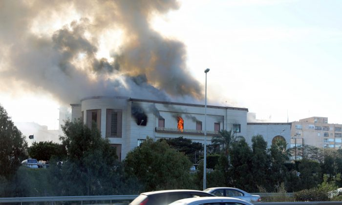 Smoke rises from the site of the headquarters of Libya's foreign ministry after suicide attackers hit in Tripoli, Libya, Dec. 25, 2018. (Reuters/Hani Amara)