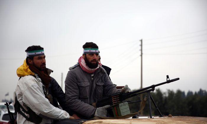 Turkish-backed Syrian fighters leave their barracks in the rebel-held border town of Jarabulus on Dec. 25, 2018, as they prepare to move towards Manbij. (Nazeer Al-Khatib/AFP)