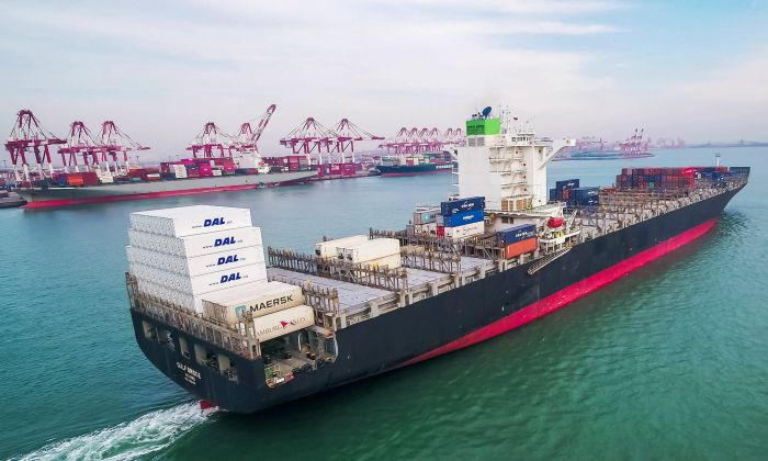 To avoid the high tariff, there are more and more Chinese products transshipped to a third country before ship to the United States. (STR/AFP/Getty Images)