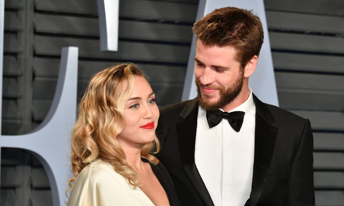 Miley Cyrus (L) and Liam Hemsworth attend the 2018 Vanity Fair Oscar Party at Wallis Annenberg Center for the Performing Arts in Beverly Hills, Calif., on March 4, 2018. (Dia Dipasupil/Getty Images)