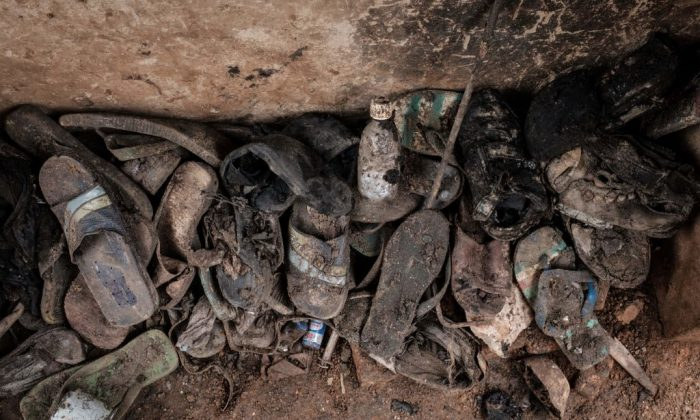Victims' items collected from a pit which was used as mass grave during 1994 Rwandan genocide and hidden under a house in Kabuga, on the outskirts of Kigali, Rwanda. The photo taken on April 30, 2018. (Yasuyoshi Chiba/AFP/Getty Images)