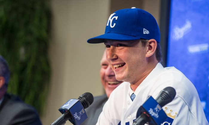The 2018 Kansas City Royals first-round pick pitcher Brady Singer smiles during a press conference before the game between the Cleveland Indians and the Kansas City Royals at Kauffman Stadium in Kansas City, Missouri on July 3, 2018. (Photo by Brian Davidson/Getty Images)