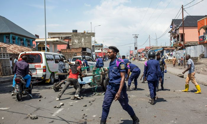 Congolese National Police clear a road in Goma on Dec. 27, 2018, following a demonstration against the postponement of the general elections in this area because of the Ebola outbreak, announced the day before by the Congolese national committee. (Patrick Meinhardt/AFP/Getty Images)