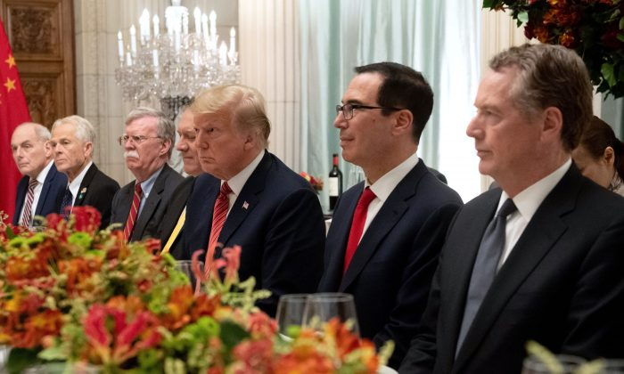 President Donald Trump (C), Secretary of the Treasury Steven Mnuchin (2nd R), Trade Representative Robert Lighthizer (R), White House Chief of Staff John Kelly (L), assistant to the president Peter Navarro (2nd L), national security adviser John Bolton (3rd L), and Secretary of State Mike Pompeo hold a dinner meeting with Chinese leader Xi Jinping (not pictured) at the G-20 summit in Buenos Aires, Argentina, on Dec. 1, 2018. (SAUL LOEB/AFP/Getty Images)