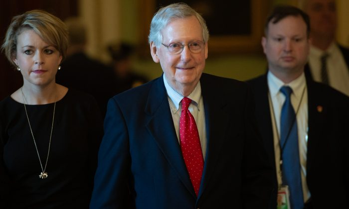 Senate Majority Leader Mitch McConnell (C) walks to his office at the U.S. Capitol on Dec. 21, 2018. (Saul Loeb/AFP/Getty Images)