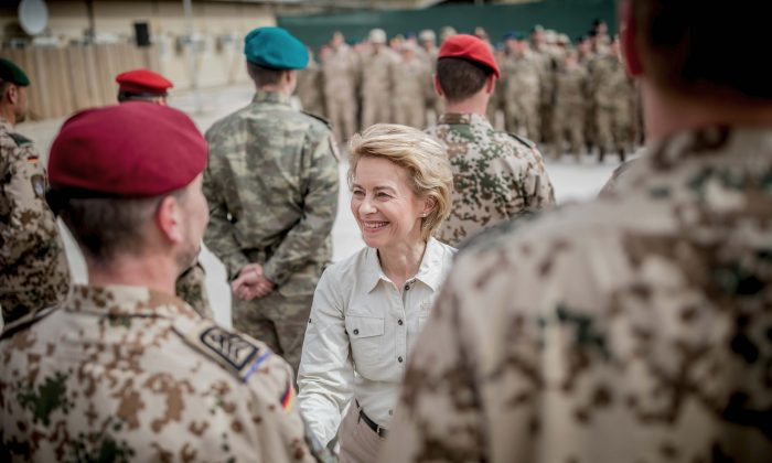 German Defense Minister Ursula von der Leyen awards medals to troops at Camp Marmal in Masar-i-Scharif, Afghanistan, on March 25, 2018. (Michael Kappeler/Pool via Reuters)