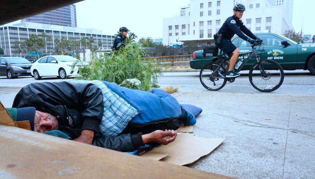 Homeless man sleeps in California