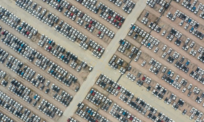 Nissan cars are seen at a storage area in Guangzhou, Guangdong Province, China on Dec. 2, 2018. (Reuters)