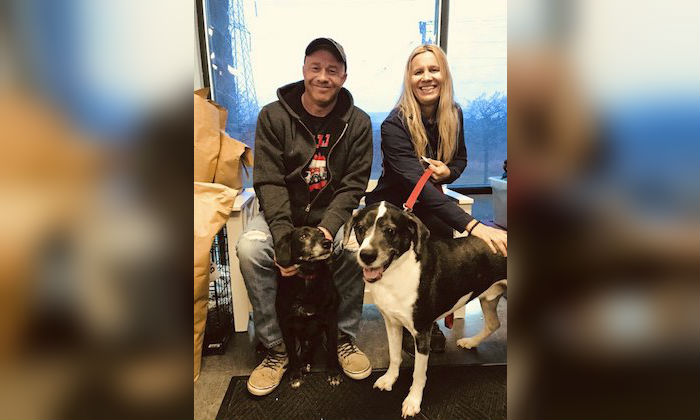 This undated photo provided by Shelly Broniec in Dec. 2018 shows Eric and Tiffany Dybas with dogs Sam and Cosmo at the shelter of PAWS Tinley Park in suburban Chicago. (Shelly Broniec via AP)