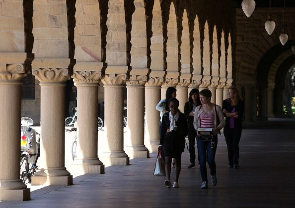 People walk through the Stanford University campus on May 22, 2014. (Justin Sullivan/Getty Images)